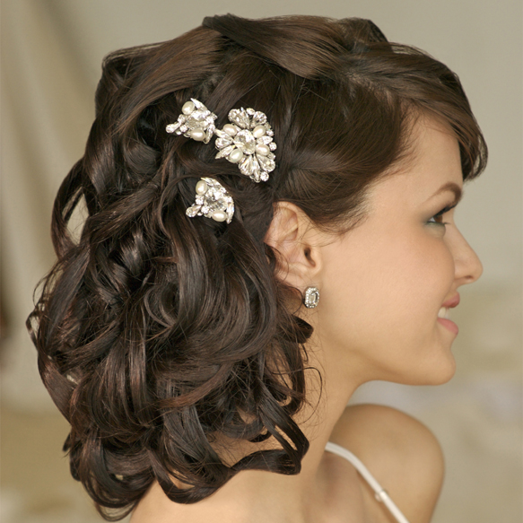 More Curly Bridal Hair Ideas: The following lovely hairdo's are from The