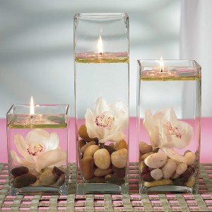 ... wedding-day , candles, stones, and orchids: cheap wedding centerpieces
