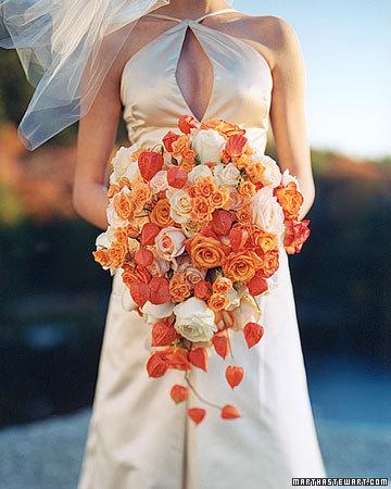below Thse wedding flowers emit a warm soft glow thanks to the orange