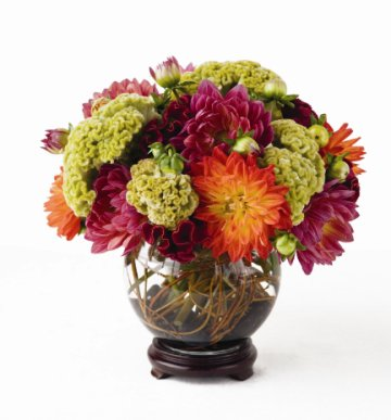 fishbowl centerpiece placed on a stained wooden stand wedding flowers and