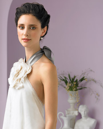 All photos Martha Stewart Weddings Halter gown with organza flower by