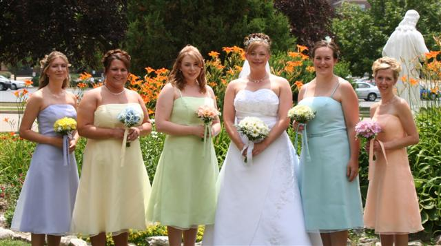 multiple colors of daisies bridal party
